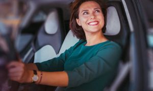 Woman smiling in new car
