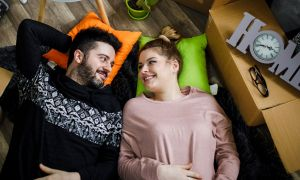 Couple laying on floor in new home